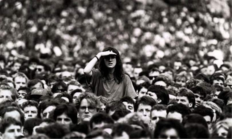 looking around in a crowd